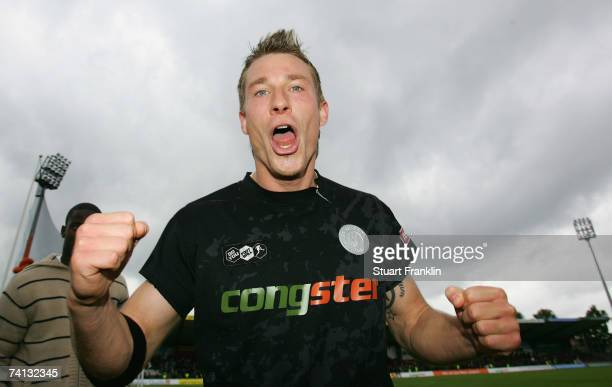 Marvin Braun of St. Pauli celebrates promotion at the end of the Third League Northern Division match between FC St.Pauli and Fortuna Dusseldorf at...