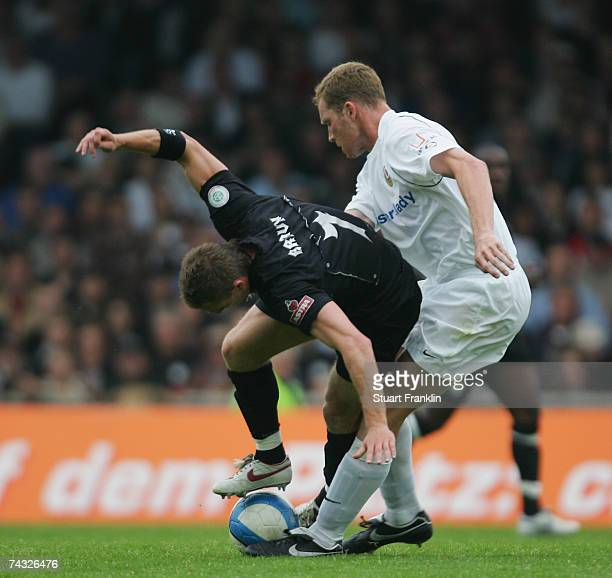 Marvin Braun of St. Pauli is challenged by Daniel Ernmenn of Dresden during the Third League Northern Division match between FC St.Pauli and Dynamo...