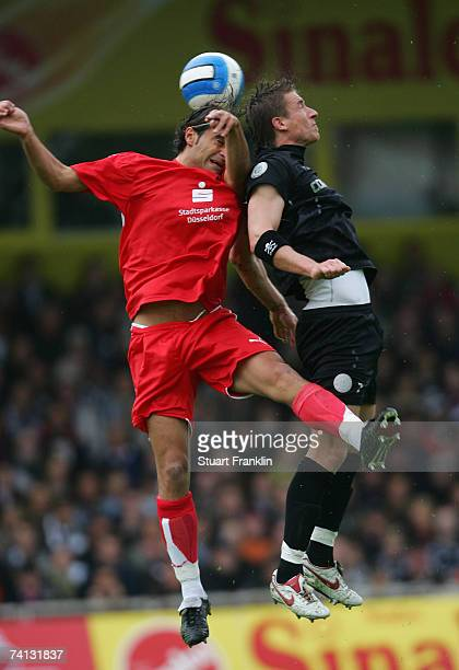 Marvin Braun of St. Pauli is challenged by David Krecidlo of Dusseldorf during the Third League Northern Division match between FC St.Pauli and...