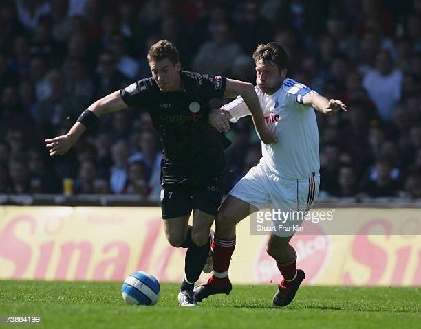 Marvin Braun of St. Pauli is challenged by Sven Boy of Kiel during the Third League match between FC St.Pauli and Holstein Kiel at the Millerntor...