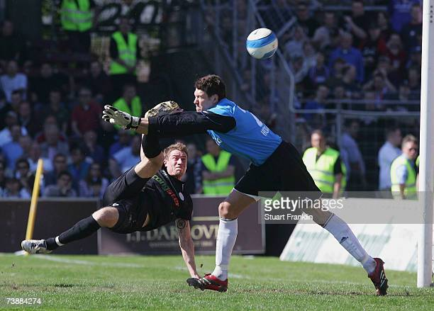 Marvin Braun of St. Pauli shoots past Adrian Horn of Kiel during the Third League match between FC St.Pauli and Holstein Kiel at the Millerntor...
