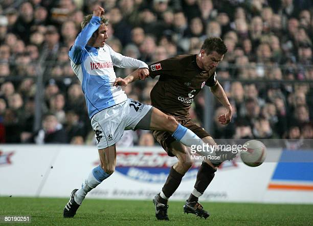 Marvin Braun of St.Pauli and Lars Bender of 1860 Munich run for the ball during the Second Bundesliga match between FC St.Pauli and 1860 Munich at...
