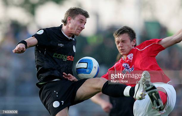 Marvin Braun of St.Pauli and Ole Kittner of Ahlen fight for the ball during the Third League match between FC St.Pauli and RW Ahlen at the Millerntor...