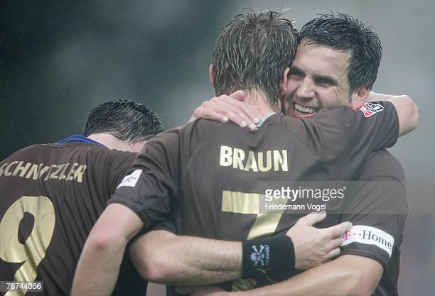 Marvin Braun of St.Pauli celebrates scoring the second goal with Thomas Meggle and Rene Schnitzler during the Second Bundesliga match between FC...