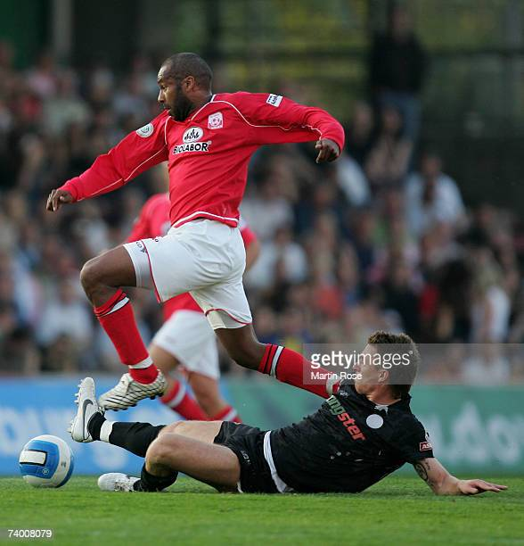 Marvin Braun of St.Pauli tries to stop Musemestre Bamba of Ahlen during the Third League match between FC St.Pauli and RW Ahlen at the Millerntor...
