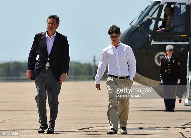 Marvin Bush the brother of US President George W Bush and his son Walker make their way from a helicopter May 11 2008 at the Texas State Technical...