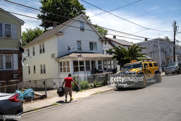 Marvin carries his son Neysel 10 weeks to their rented home on June 25 2020 in Stamford Connecticut Marvin his wife Zully and their son Junior...
