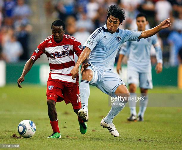 Marvin Chavez of FC Dallas and Roger Espinoza of Sporting KC compete for the ball in the first half at Livestrong Sporting Park on August 27 2011 in...