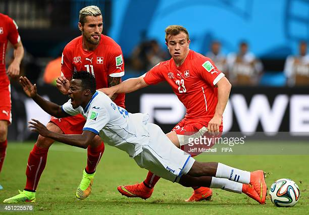 Marvin Chavez of Honduras is brought down by Xherdan Shaqiri of Switzerland during the 2014 FIFA World Cup Brazil Group E match between Honduras and...