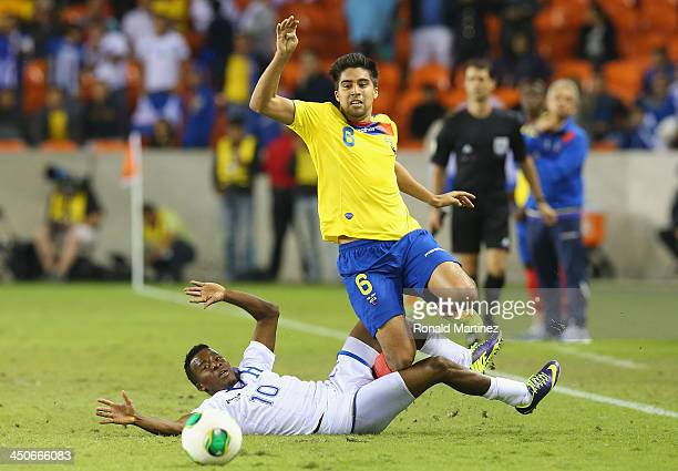 Marvin Chavez of Honduras trips up Christian Noboa of Ecuador during an international friendly match at BBVA Compass Stadium on November 19 2013 in...