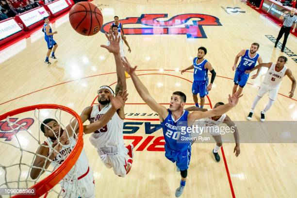 Marvin Clark II of the St John's Red Storm and Martin Krampelj of the Creighton Bluejays battle for the rebound at Carnesecca Arena on January 16...