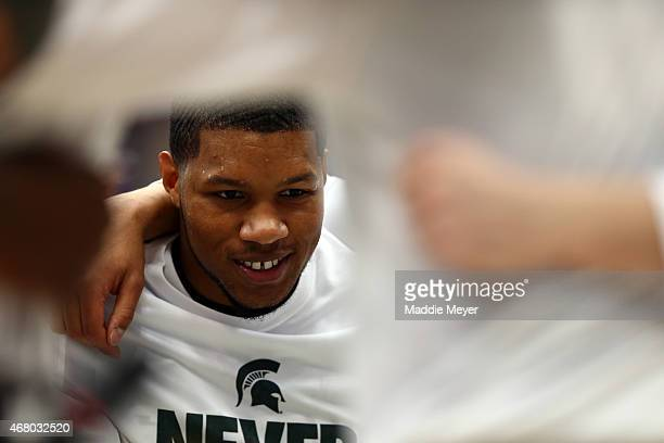 Marvin Clark Jr #0 of the Michigan State Spartans looks on from the huddle with his team prior to the start of the game against the Louisville...