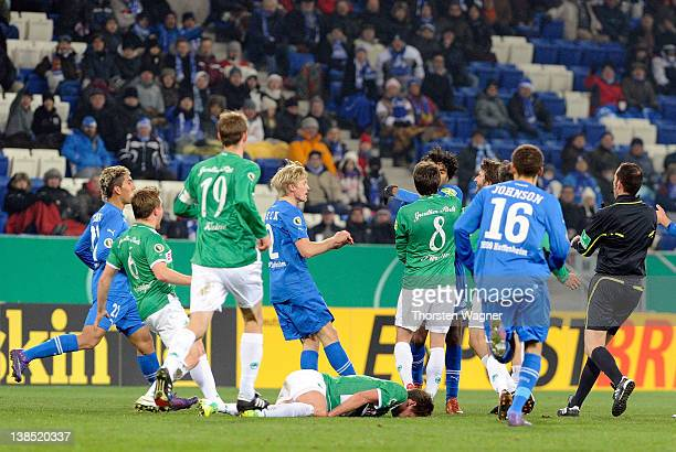 Marvin Comper of Hoffenheim in action with Stephan Fuerstner of Fuerth during the DFB Cup Quarter Final match between TSG 1899 Hoffenheim and SpVgg...