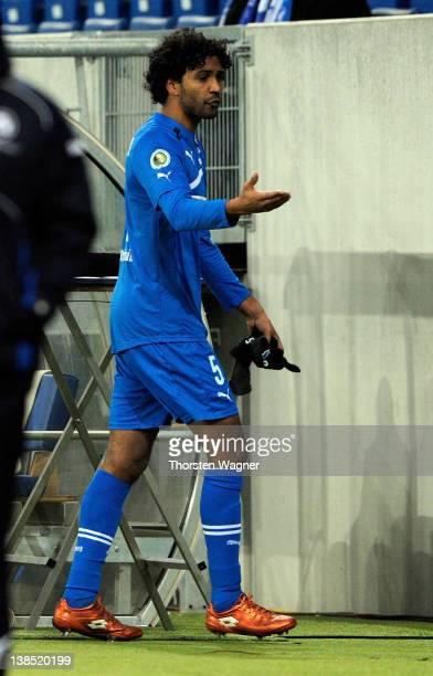 Marvin Comper of Hoffenheim must leave the pitch after showing the red card during the DFB Cup Quarter Final match between TSG 1899 Hoffenheim and...