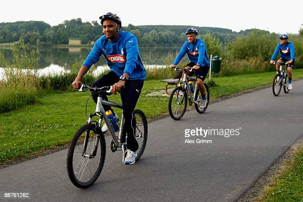 Marvin Compper and team mates drive their bicycles during a training camp of 1899 Hoffenheim on June 30, 2009 in Stahlhofen am Wiesensee, Germany.