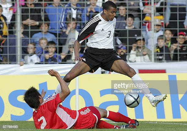 Marvin Compper of Germany jumps over Zhao Ming of China during the match between Germany and China in the men's under 20's International on May 11...