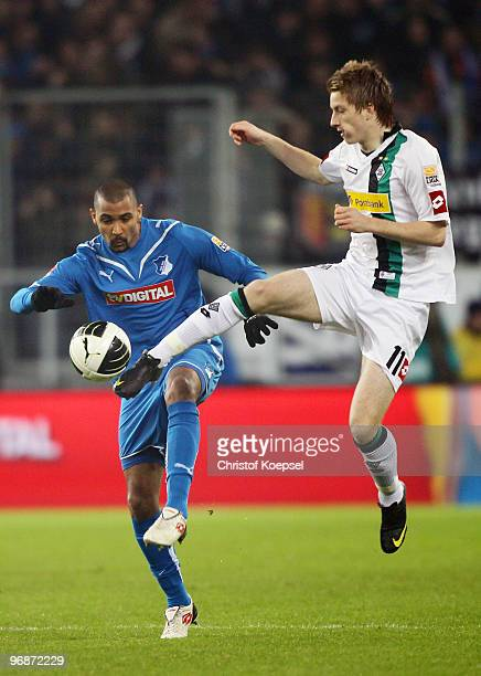 Marvin Compper of Hoffenheim and Marco Reus of Gladbach battle for the ball during the Bundesliga match between 1899 Hoffenheim and Borussia...