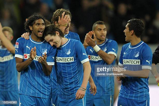 Marvin Compper of Hoffenheim and teammate Sebastian Rudy celebrate after the Bundesliga match between TSG 1899 Hoffenheim and FC Schalke 04 at...