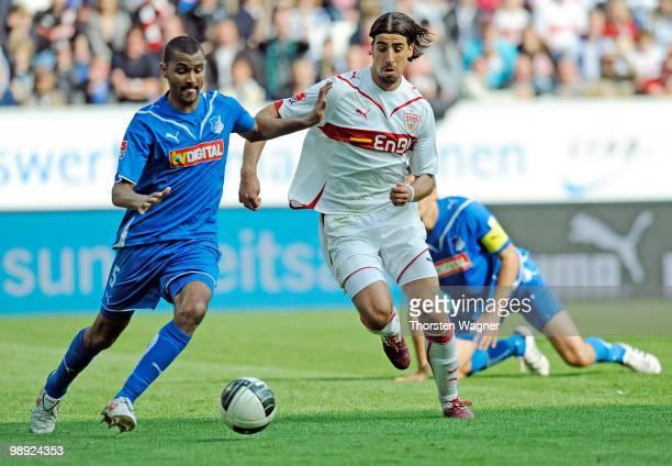 Marvin Compper of Hoffenheim battles for the ball with Sami Khedira of Stuttgart during the Bundesliga match between TSG 1899 Hoffenheim and VFB...