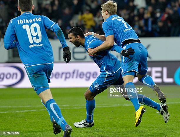 Marvin Compper of Hoffenheim celebrates after scoring the opening goal with a headkick against Julian Schieber of Nuernberg during the Bundesliga...