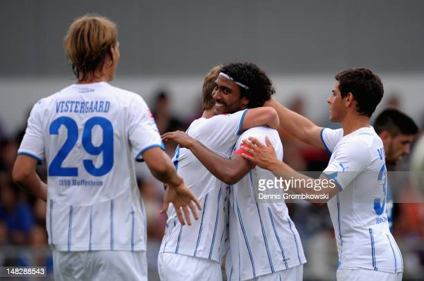 Marvin Compper of Hoffenheim celebrates with teammates after scoring his team's opening goal during the friendly match between FCAstoria Walldorf and...