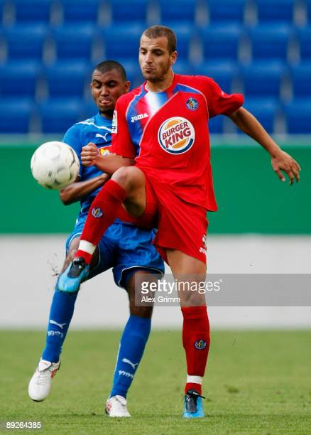 Marvin Compper of Hoffenheim challenges Soldado of Getafe during the pre season friendly match between 1899 Hoffenheim and FC Getafe at the...
