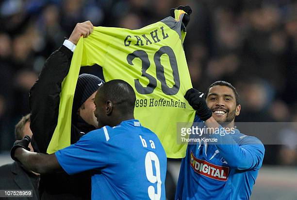 Marvin Compper of Hoffenheim holds up a jersey of his injured goalkeeper Jens Grahl after he scored the opening goal during the Bundesliga match...