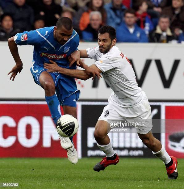 Marvin Compper of Hoffenheim is challenged by Yacine Abdessadki of Freiburg during the Bundesliga match between 1899 Hoffenheim and SC Freiburg at...