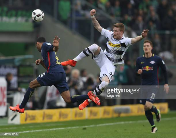 Marvin Compper of Leipzig is challenged by Andre Hahn of Gladbach during the Bundesliga match between Borussia Moenchengladbach and RB Leipzig at...