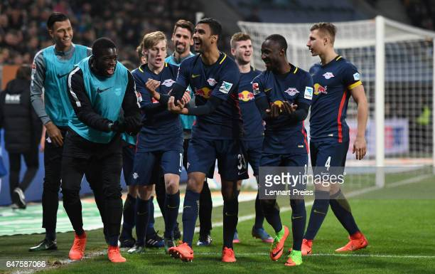Marvin Compper of RB Leipzig and his teammates celebrate their side's second goal during the Bundesliga match between FC Augsburg and RB Leipzig at...