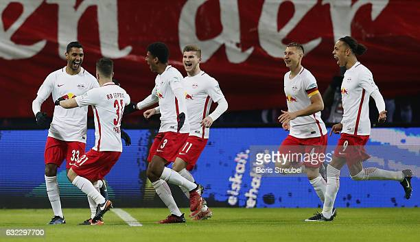 Marvin Compper of RB Leipzig celebrates with team mates after scoring his team's first goal during the Bundesliga match between RB Leipzig and...