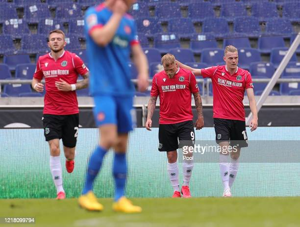 Marvin Ducksch of Hannover 96 celebrates with John Guidetti after scoring his team's first goal during the Second Bundesliga match between Hannover...