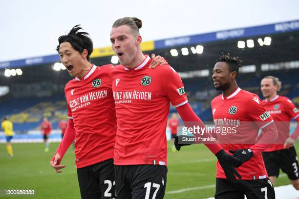 Marvin Ducksch of Hannover 96 celebrates with team mate Sei Muroya after scoring his team's second goal during the Second Bundesliga match between...
