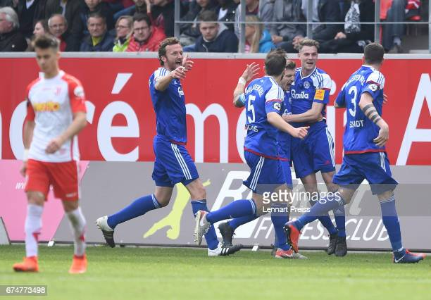 Marvin Ducksch of Holstein Kiel and his teammates celebrate their side's second goal during the 3 Liga match between Jahn Regensburg and Holstein...