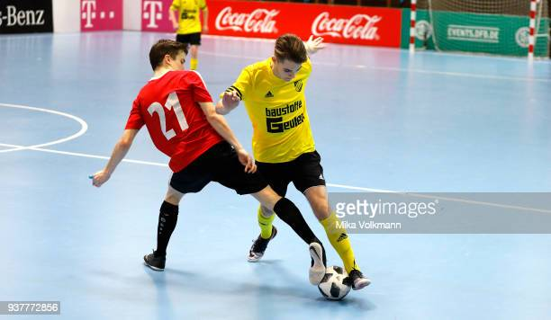 Marvin Dumslaff of Walheim fights for the ball against Julian Frick of Eppingen during the final of the DFB Indoor Football match between VFB...
