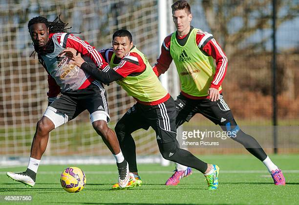 Marvin Emnes Jefferson Montero and Federico Fernandez of Swansea City in action during a training session at the Fairwood training ground on February...