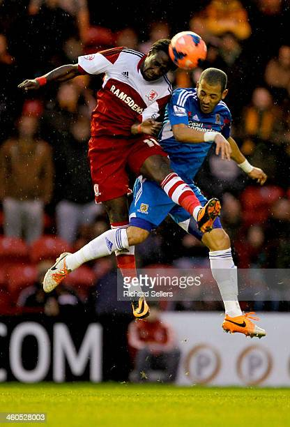 Marvin Emnes of Middlesbrough challenges Liam Rosenior of Hull during the Budwieser FA Cup Third round match between Middlesbrough and Hull City at...