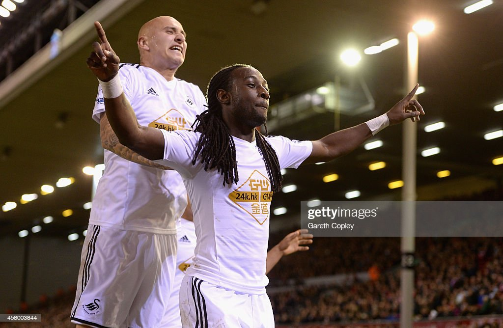 Marvin Emnes of Swansea celebrates scoreing the opening goal with Jonjo Shelvey during the Capital One Cup Fourth Round match between Liverpool and Swansea City at Anfield on October 28, 2014 in Liverpool, England.