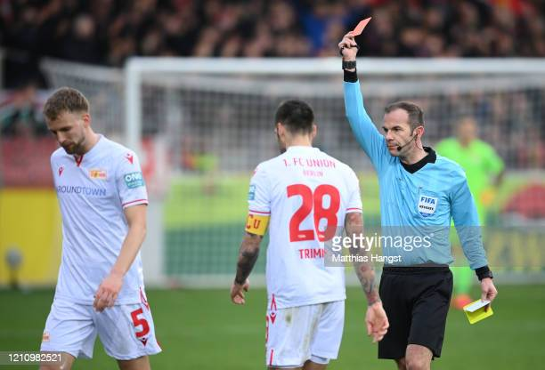 Marvin Friedrich of 1.FC Union Berlin is shown his second yellow card which results in a red card which is showed by referee Marco Fritz during the...