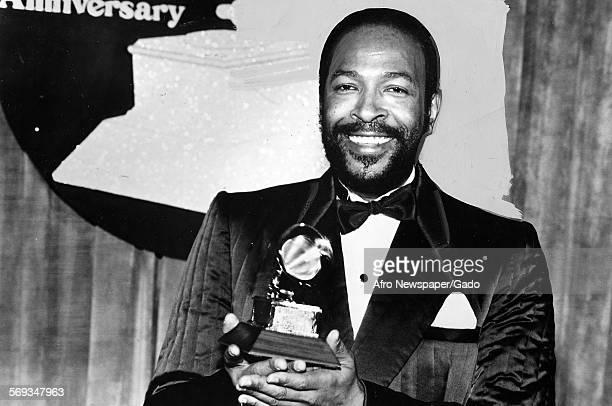 Marvin Gaye holding a Grammy award, 1982.