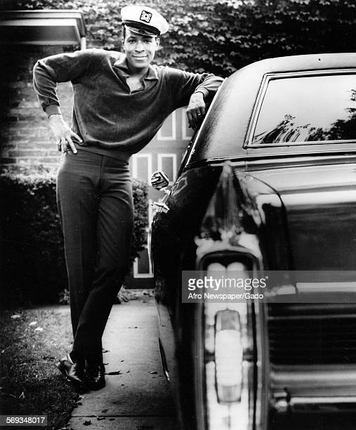 Marvin Gaye wearing a sailor hat and leaning on a car 1961