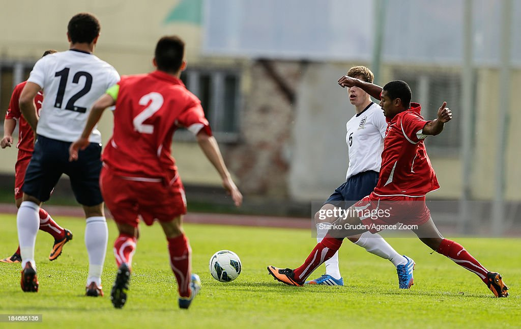 Marvin Graf of Switzerland and Lewis Baker of England during the UEFA U19 Championships Qualifier between England and Switzerland, on October 15, 2013 in Ptuj, Slovenia.