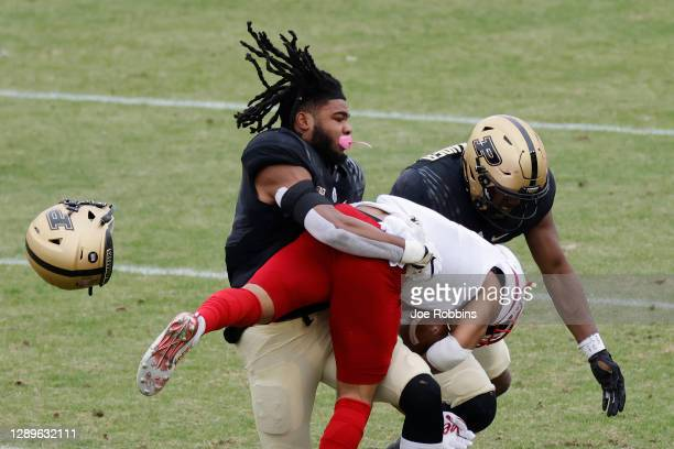 Marvin Grant of the Purdue Boilermakers loses his helmet while tackling Wan'Dale Robinson of the Nebraska Cornhuskers during the game at Ross-Ade...