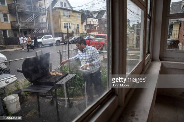 Marvin grills steaks in front of his home on June 28 2020 in Stamford Connecticut Marvin his wife Zully and their son Junior survived Coronavirus in...