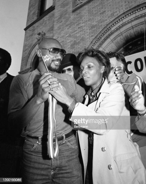 Marvin Hagler, boxing's new middleweight champion, shows his wife Bertha the 'key to the city' of his hometown, Brockton, MA. The key was presented...