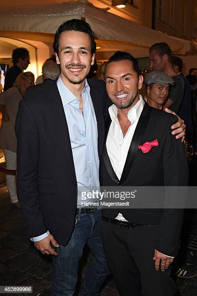 Marvin Herzsprung and Marcus Heinzelmann attend the Marcus Heinzelmann Boutique Opening on July 29 2014 in Munich Germany