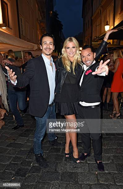 Marvin Herzsprung Valentina Pahde and Marcus Heinzelmann attend the Marcus Heinzelmann Boutique Opening on July 29 2014 in Munich Germany