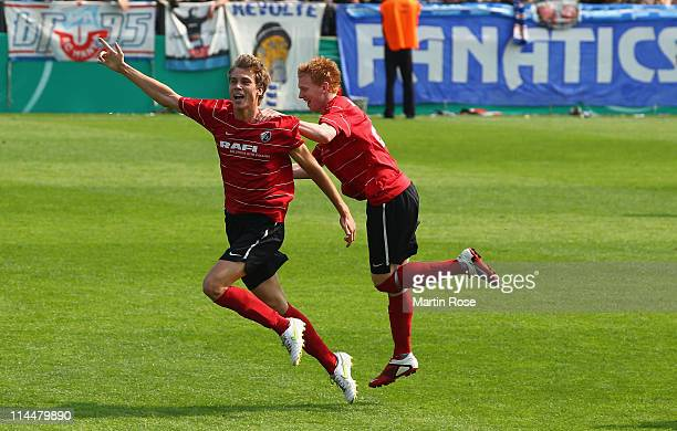 Marvin Hezel of Freiburg celebrates with team mate Nico Gutjahr after he scored his team's opening goal during the DFB Junior Cup final match between...