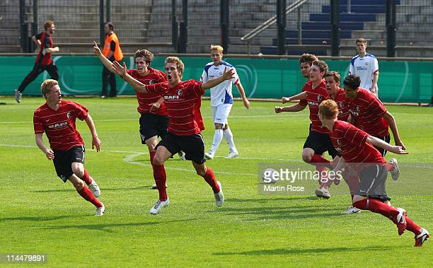 Marvin Hezel of Freiburg celebrates with team mates after he scored his team's opening goal during the DFB Junior Cup final match between Hansa...