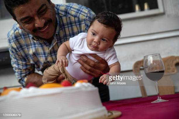 Marvin holds his son Neysel 10 weeks at a dinner celebrating Neysel's three month birthday on June 28 2020 in Stamford Connecticut The Guatemalan...